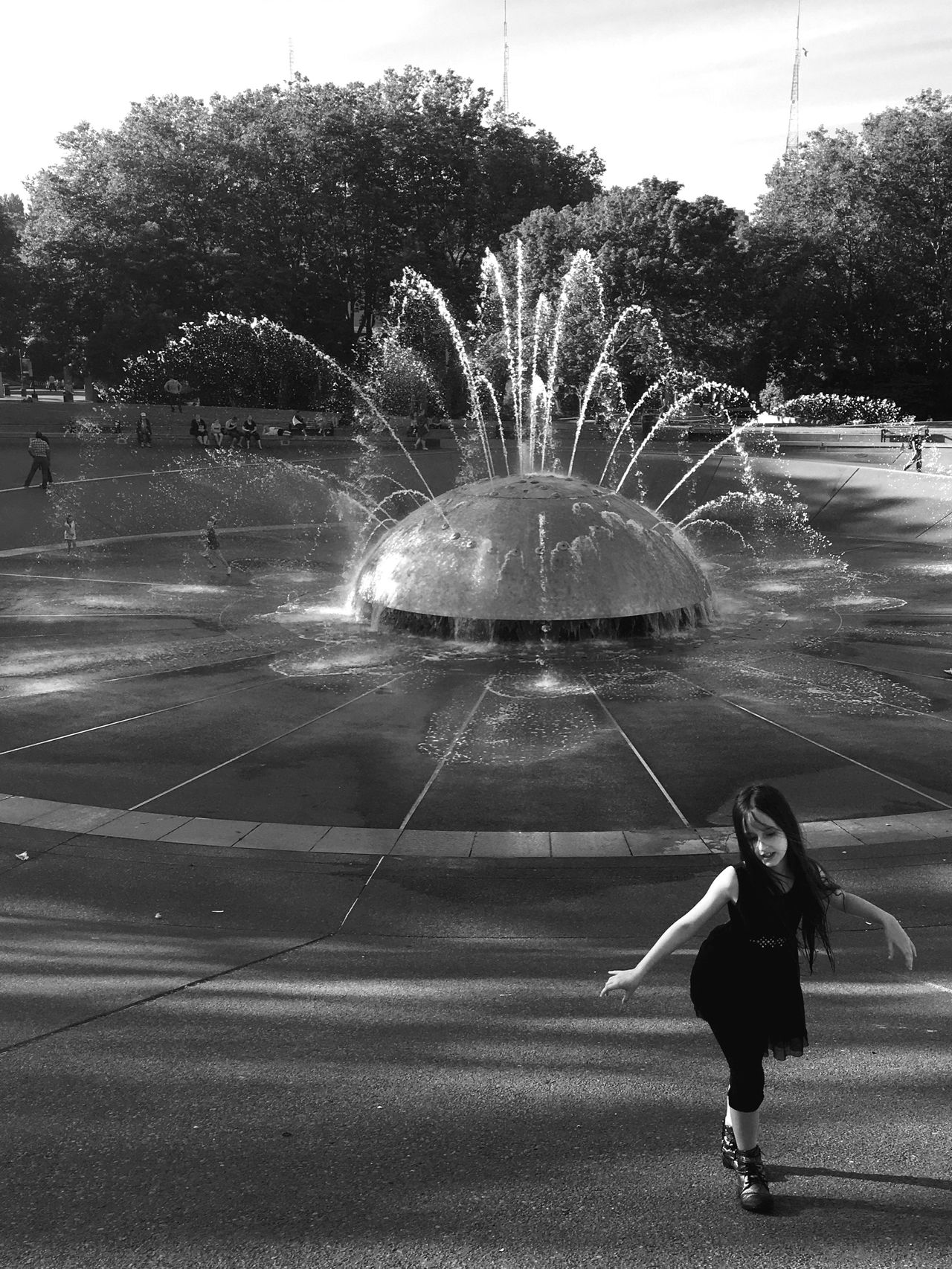 """Life isn't about waiting for the storm to pass...It's about learning to dance in the rain."" -Vivian Greene Black And White Blackandwhite Girl Power Girl Freedom Dance IPhoneography This Week On Eyeem Capture The Moment Mobilephotography People Photography Summerfun Exceptional Photographs EyeEm Best Shots Seattle Center Seattlecenterfountain Fountain Seattle Dancing Dancing Girl Happiness People And Places Monochrome Photography"