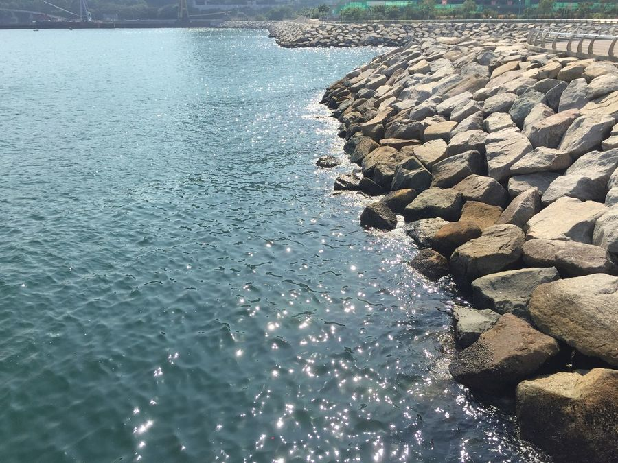 Sunny day at Tseung Kwon O Water Sea No People Nature Beauty In Nature Day Rock - Object Outdoors Sunlight Pebble Beach Sky Promenade Reflection Reflections In The Water
