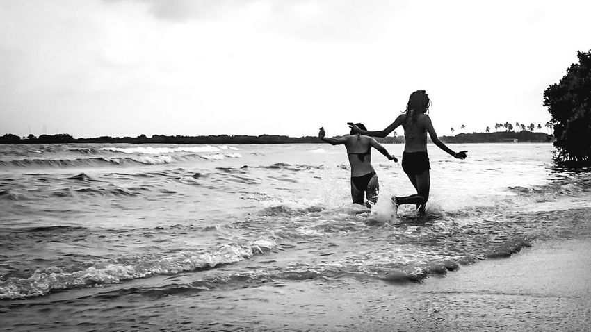 Two People Beach Sea Togetherness Child Vacations Girls Happiness Women People Adult Family Females Childhood Fun Enjoyment Outdoors Men Wave Bonding Lifestyles Horizon Over Water Sunlight Fun Vitality Women Around The World