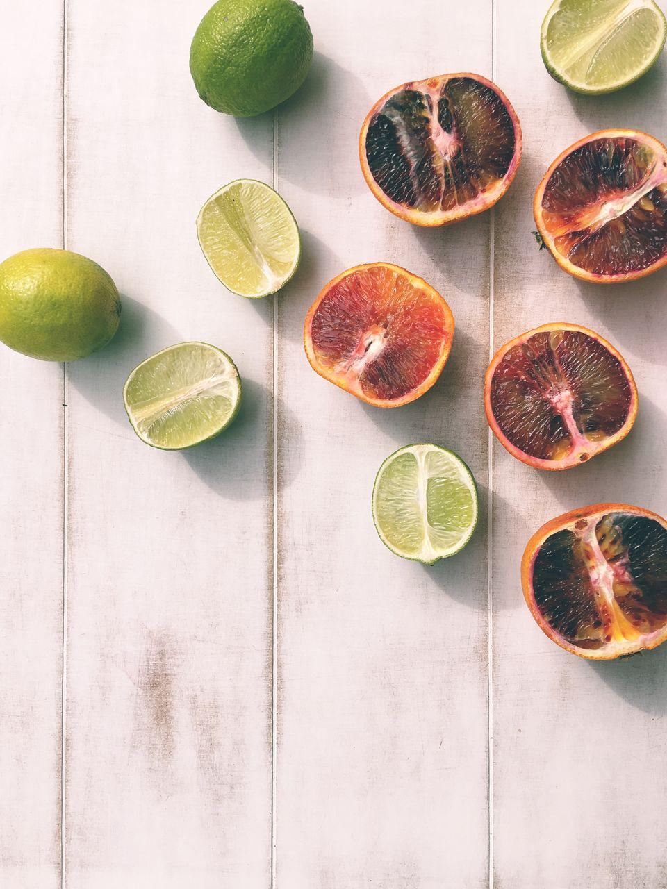 fruit, citrus fruit, cross section, lemon, healthy eating, slice, freshness, halved, lime, food and drink, still life, grapefruit, juicer, no people, indoors, food, blood orange, high angle view, table, studio shot, pomegranate, drink, day, sour taste, close-up