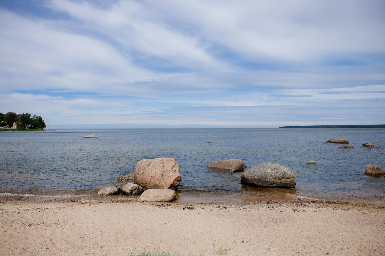 water, nature, sky, sea, scenics, cloud - sky, tranquility, beauty in nature, beach, rock - object, tranquil scene, horizon over water, outdoors, no people, day