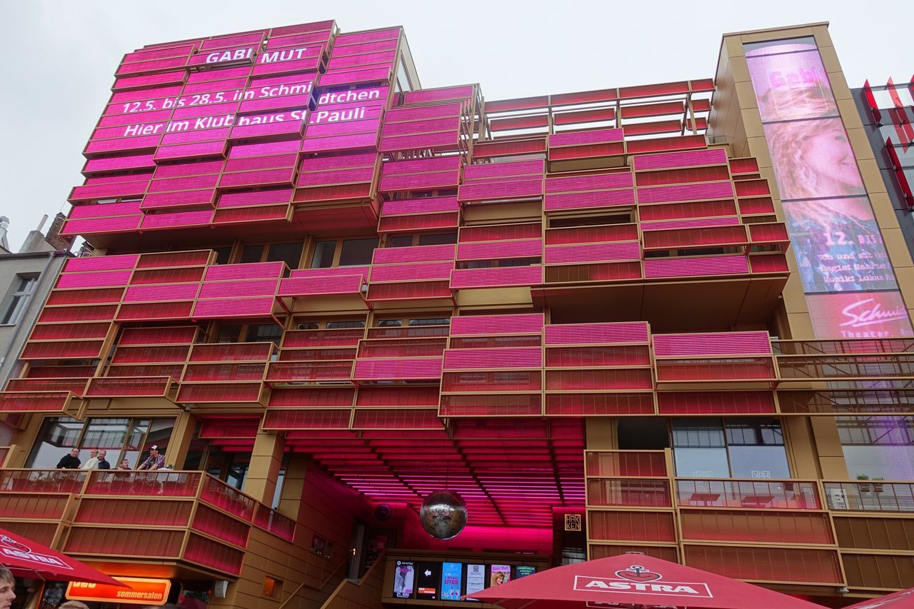 Reeperbahn Architecture Balcony Building Exterior Built Structure Day Low Angle View No People Outdoors Pink Color Purple Reeperbahn  Residential Building Sky Variation Colors Window