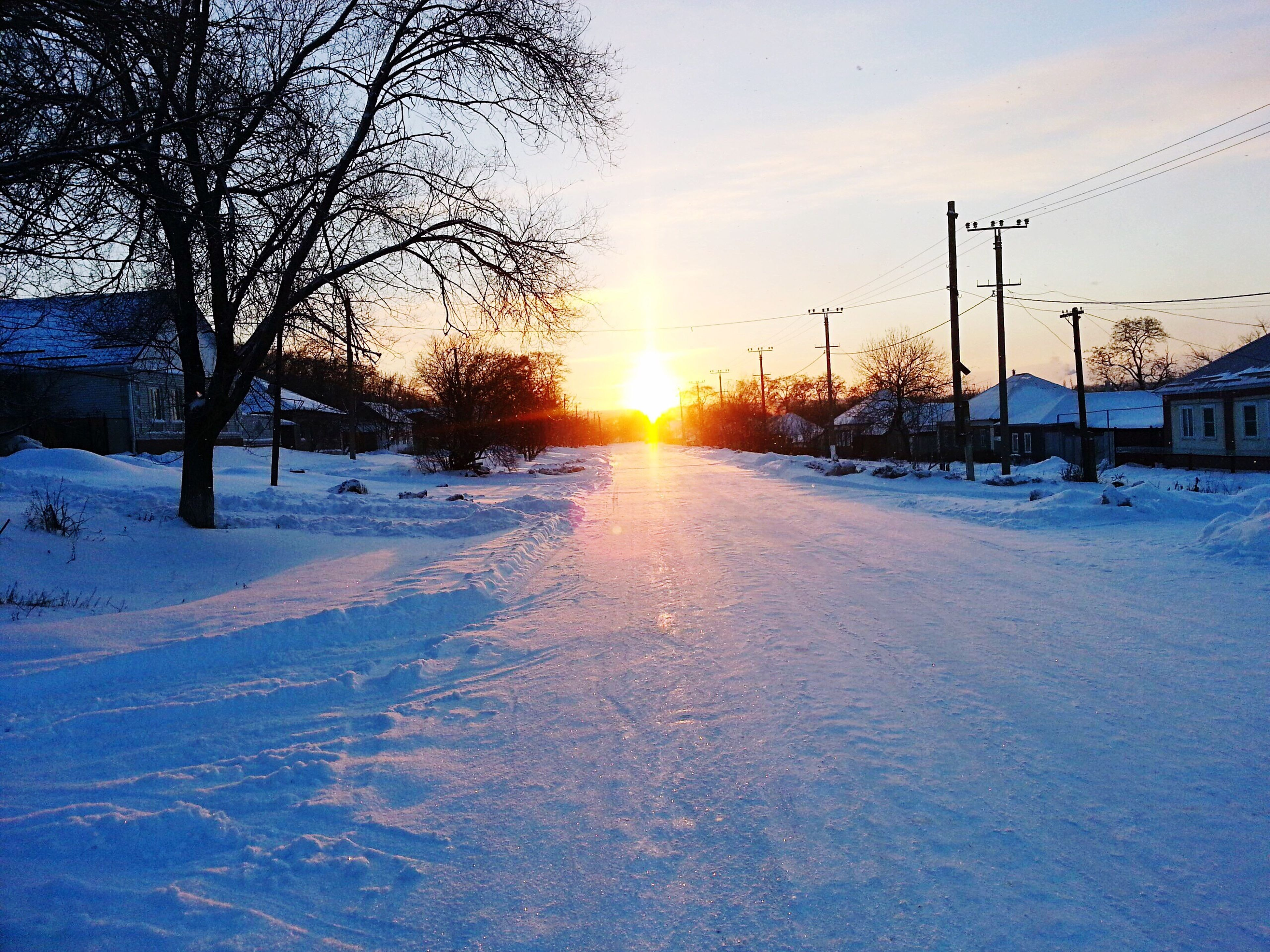 cold temperature, snow, sunset, winter, sun, sunlight, sky, beauty in nature, nature, weather, tree, sunbeam, transportation, no people, outdoors, road, scenics, day