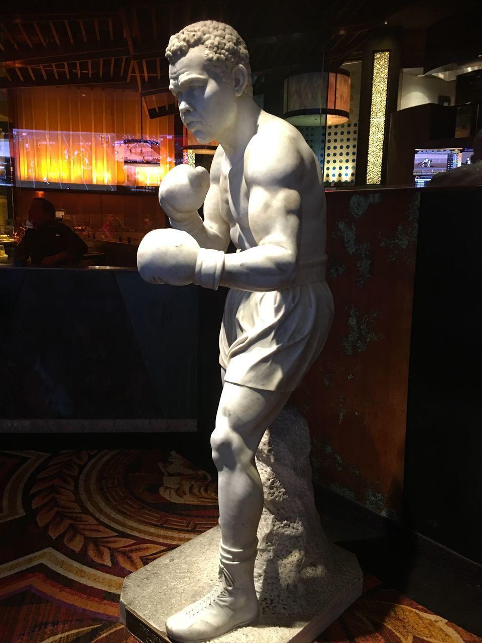 statue, human representation, sculpture, male likeness, art and craft, spirituality, religion, indoors, illuminated, night, no people