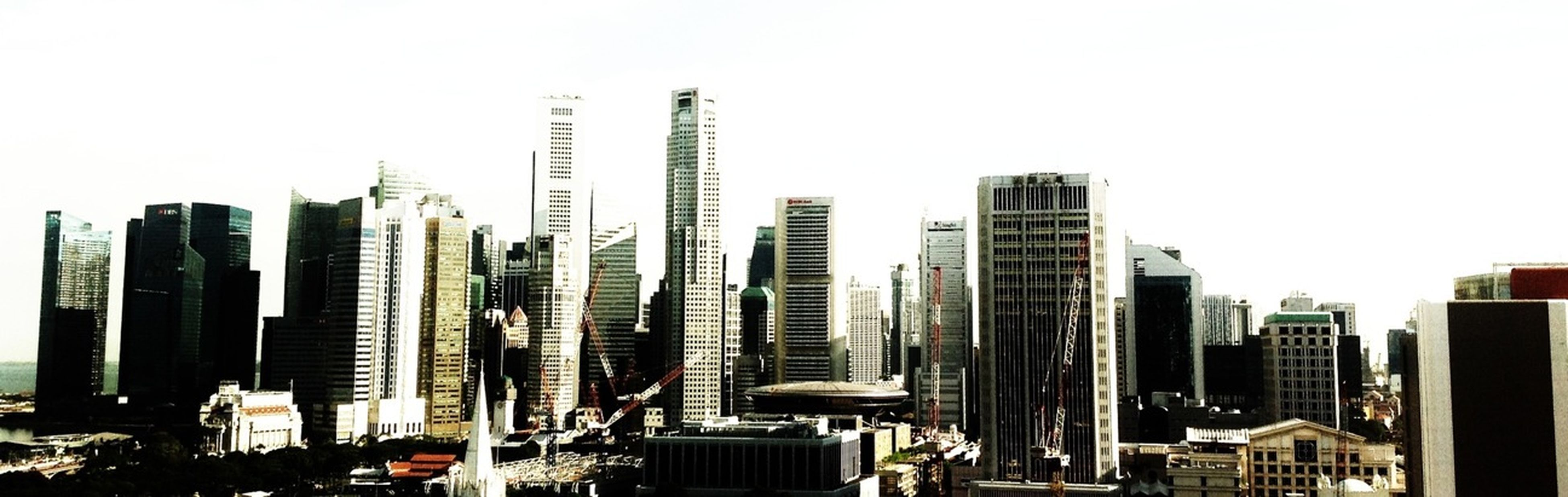 building exterior, skyscraper, city, architecture, built structure, tall - high, clear sky, modern, cityscape, office building, tower, urban skyline, development, financial district, tall, copy space, crowded, city life, building, capital cities