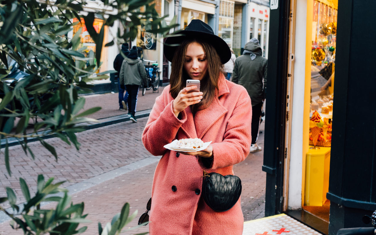 Photographing waffle in Amsterdam Amsterdam Amsterdam City Amsterdamcity Casual Clothing Day Fashion Food Food And Drink Food Photography Front View Lifestyles One Person Outdoors Phone Portrait Standing Street VSCO Waffle Waffles Warm Clothing