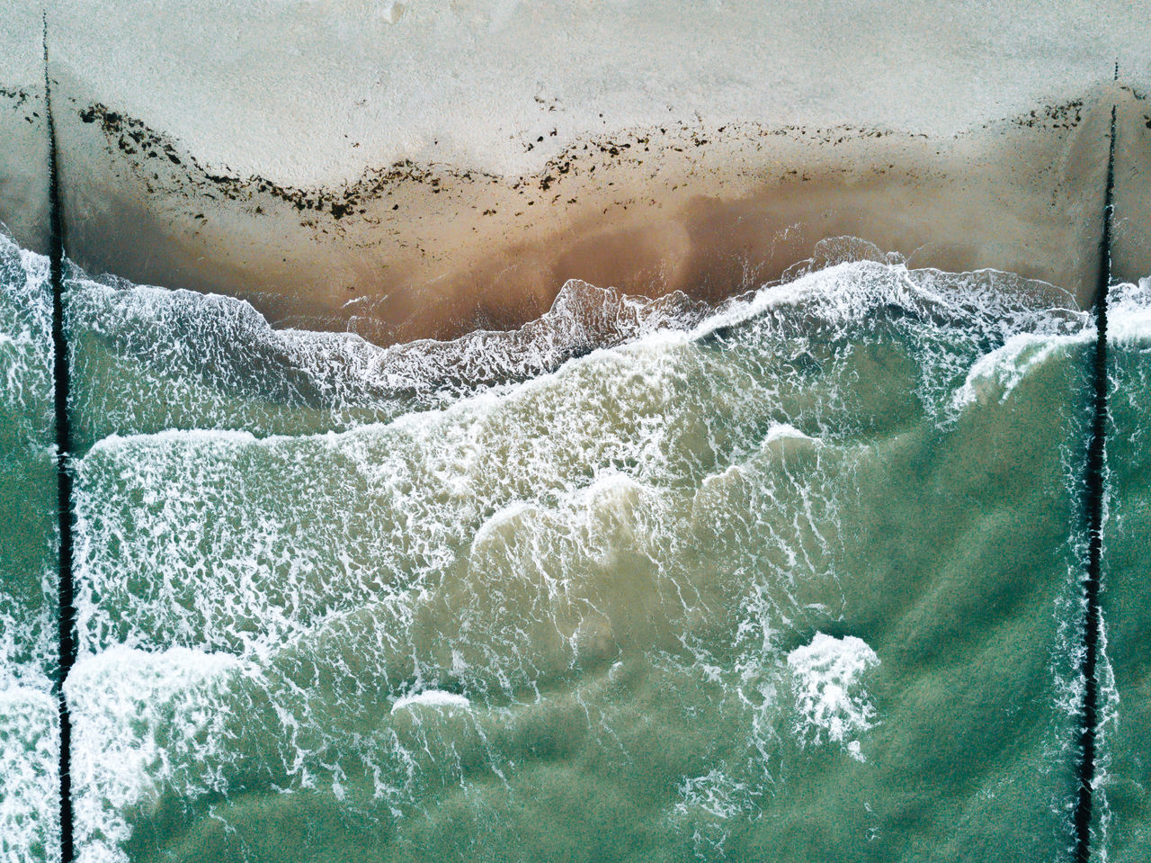 Aerial image of beach and water with waves and surfer Beach Beauty In Nature Close-up Day Motion Nature No People Outdoors Power In Nature Sea Water Wave Sommergefühle