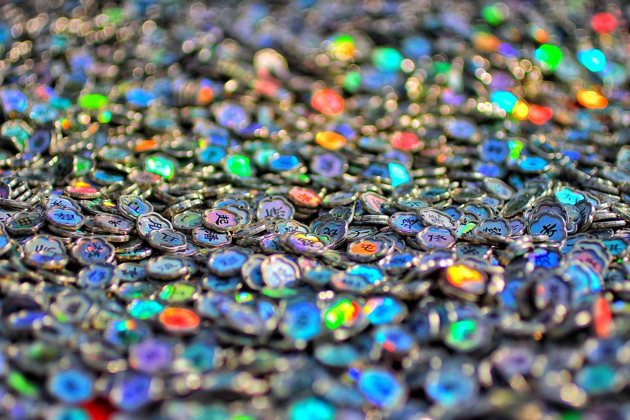selective focus, multi colored, no people, shiny, large group of objects, close-up, outdoors, day