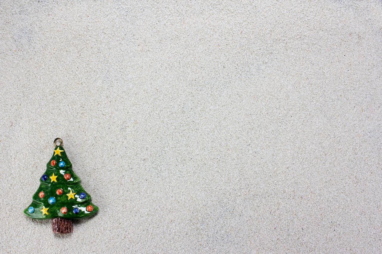 A colorful christmas tree on white snow Background Celebration Christmas Claus December Decoration Festive Holiday Merry Santa Sky Snow Tree White Winter Xmas