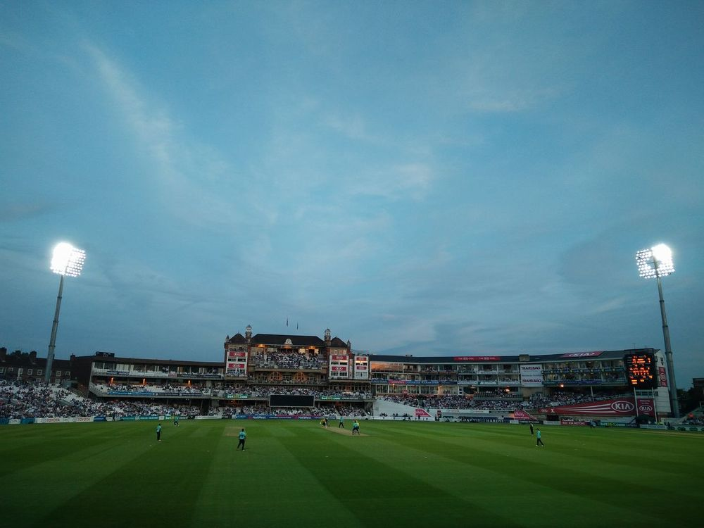 United Kingdom The Oval Blue Floodlit Grass Green Color Outdoors People Sky Sport Stadium Team Sport Cricket Match Evening Theoval London Cricket Large Group Of People Playing Field Crowd Playing Lifestyles Real People Leisure Activity