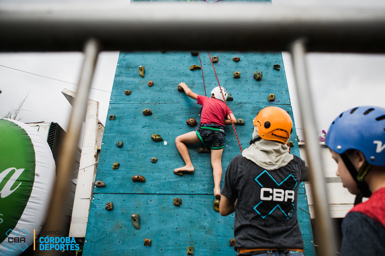 leisure activity, sport, real people, nautical vessel, rope, day, boys, climbing wall, friendship, headwear, strength, adventure, challenge, extreme sports, outdoors, helmet, togetherness, teamwork, childhood, water, people