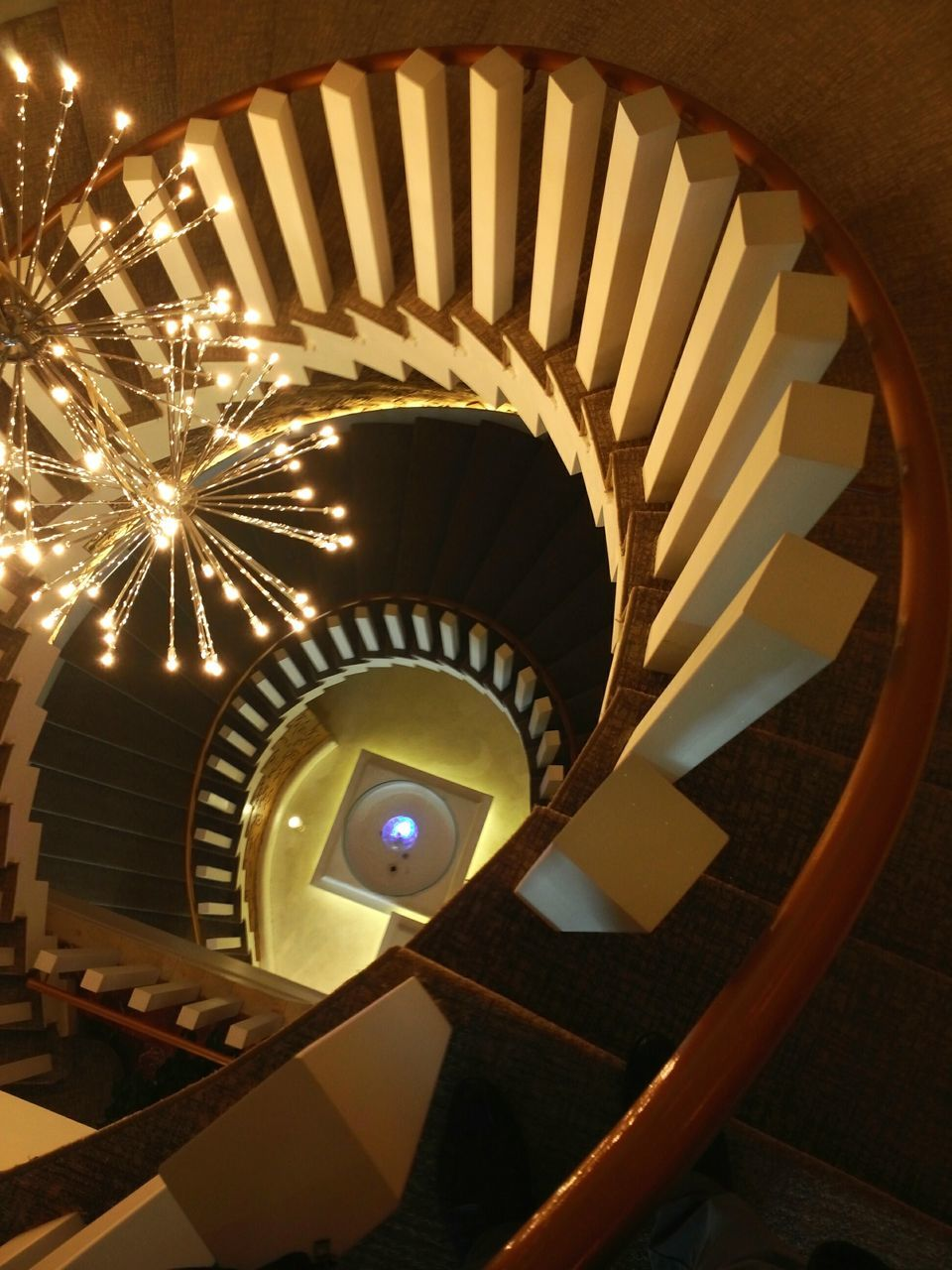 steps and staircases, staircase, railing, spiral, steps, architecture, built structure, spiral stairs, high angle view, stairs, no people, indoors, hand rail, spiral staircase, day
