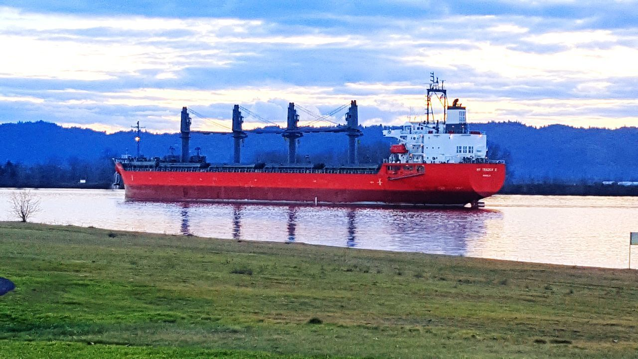 Nautical Vessel Freight Transportation Industry Red Ship Business Finance And Industry Cloud - Sky Transportation Columbia River Columbia River, WA Columbiariver River Riverside Photography Riverbank Shipping  Ships🚢 Ships ShipSpotting Ships On The Water Beach Pnwnaturescapes PNWonderland Grass River Sunset Commerce