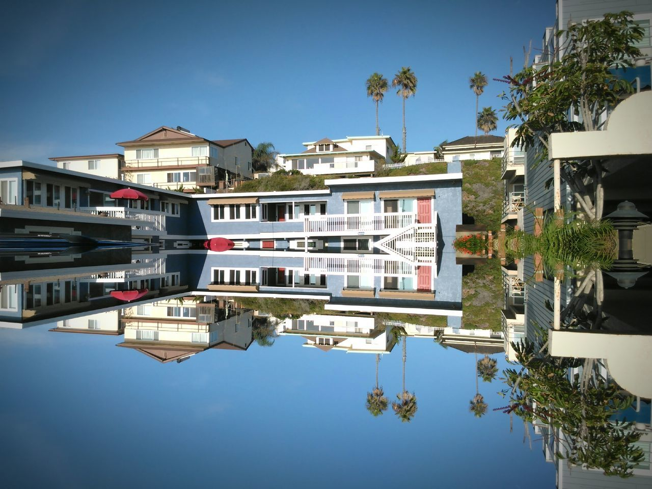 building exterior, architecture, built structure, clear sky, residential building, reflection, house, outdoors, day, waterfront, tree, water, no people, sky, city