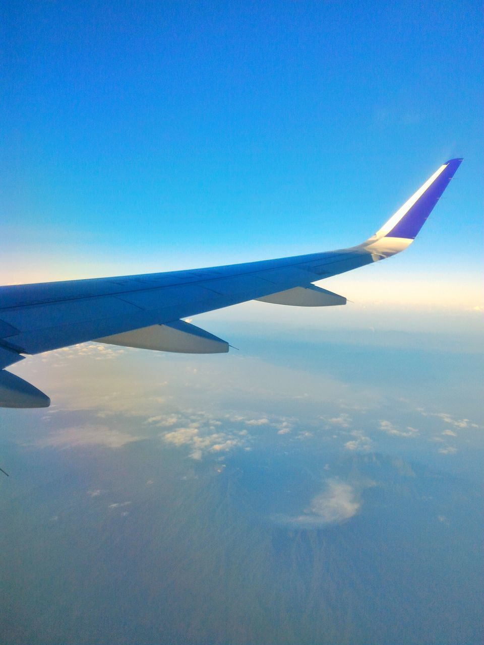 airplane, aerial view, airplane wing, journey, blue, transportation, flying, air vehicle, nature, travel, sky, no people, aircraft wing, scenics, beauty in nature, mid-air, outdoors, tranquility, day, tranquil scene, landscape