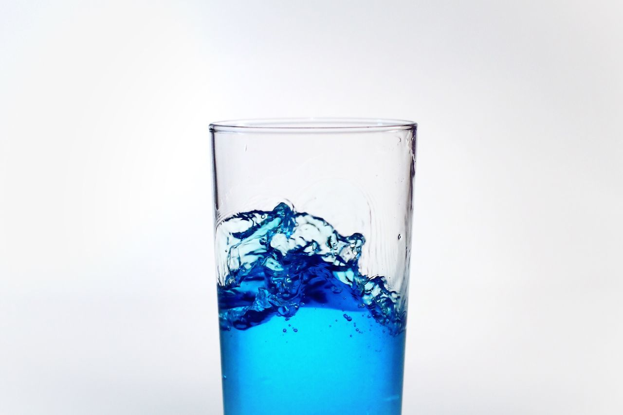 Studio Shot Glass - Material Transparent White Background No People Cold Temperature Cube Shape Drinking Glass Water Refreshment Close-up Impact Freshness Drinking Water Horizontal Photography Color Image Blue Ink Full Frame Neat Copy Space Indoors  Fragility Water