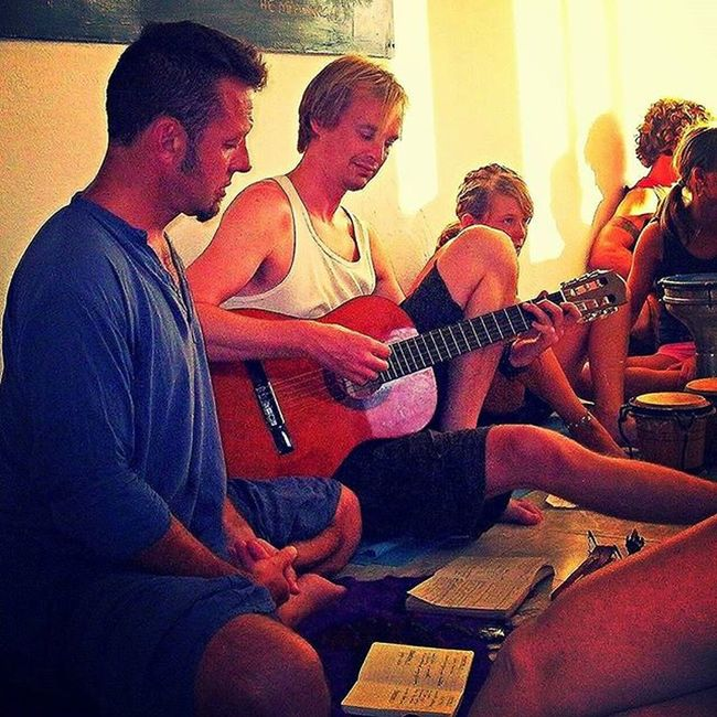 Nothing quite opens the heart On a Yoga Retreat or Yogaholiday than Kirtan or Bhajan Chanting Mantras is well known for drilling the Chatteringmind and Openingtheheart Kirtan takes that to another level. It's more Emotional and more of a Community or Sangha experience You will often see people crying at Kirtan , releasing emotions , as their hearts open to previously contstrained emotions and Feelings I love leading Kitran just as much as I look pushing athletic guys through tough core exercises Here I am leading a Kirtan in Crete in 2007 where I was reaching at Yogaplus The course was two weeks of Mantra Pranayama Meditation