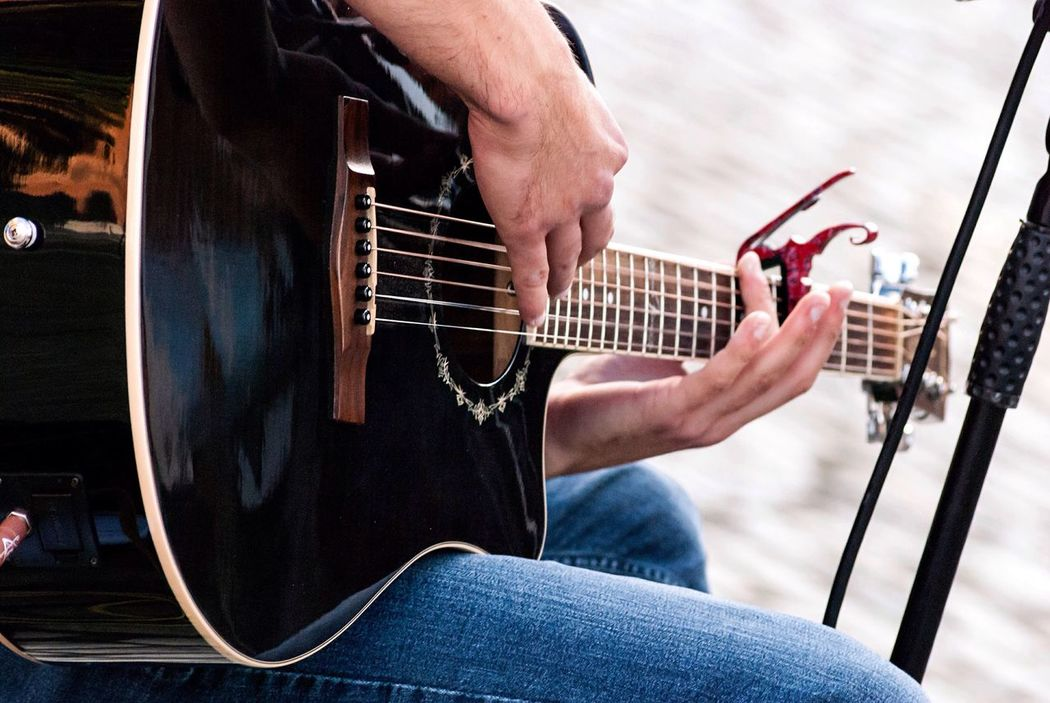 Music it's something you feel. Person Playing Guitar Music Men Musical Instrument Hobbies First Eyeem Photo