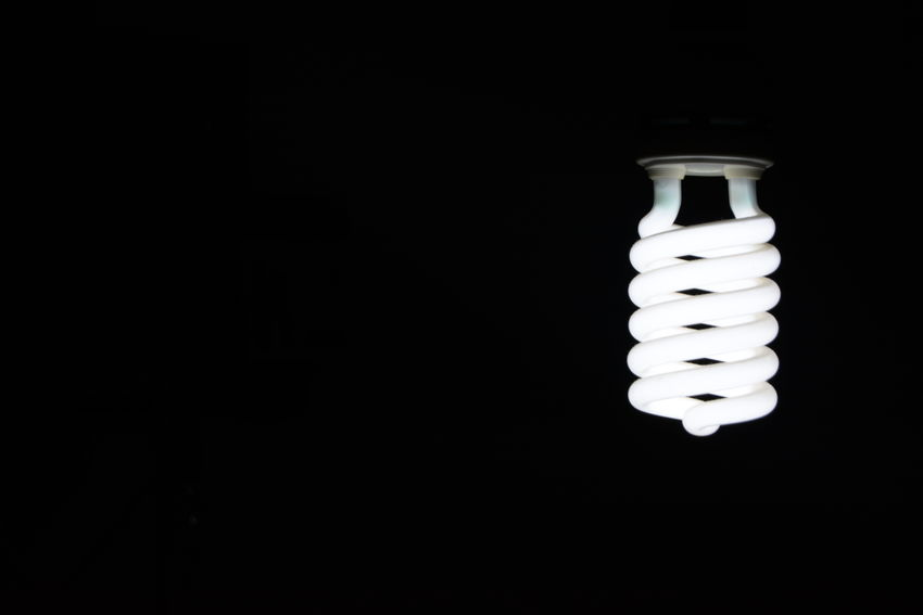 Black Background Close-up Day Electricity  Energy Efficient Energy Efficient Lightbulb Fluorescent Fuel And Power Generation Glowing Illuminated Indoors  Light Bulb Lighting Equipment Low Angle View No People Spiral Technology