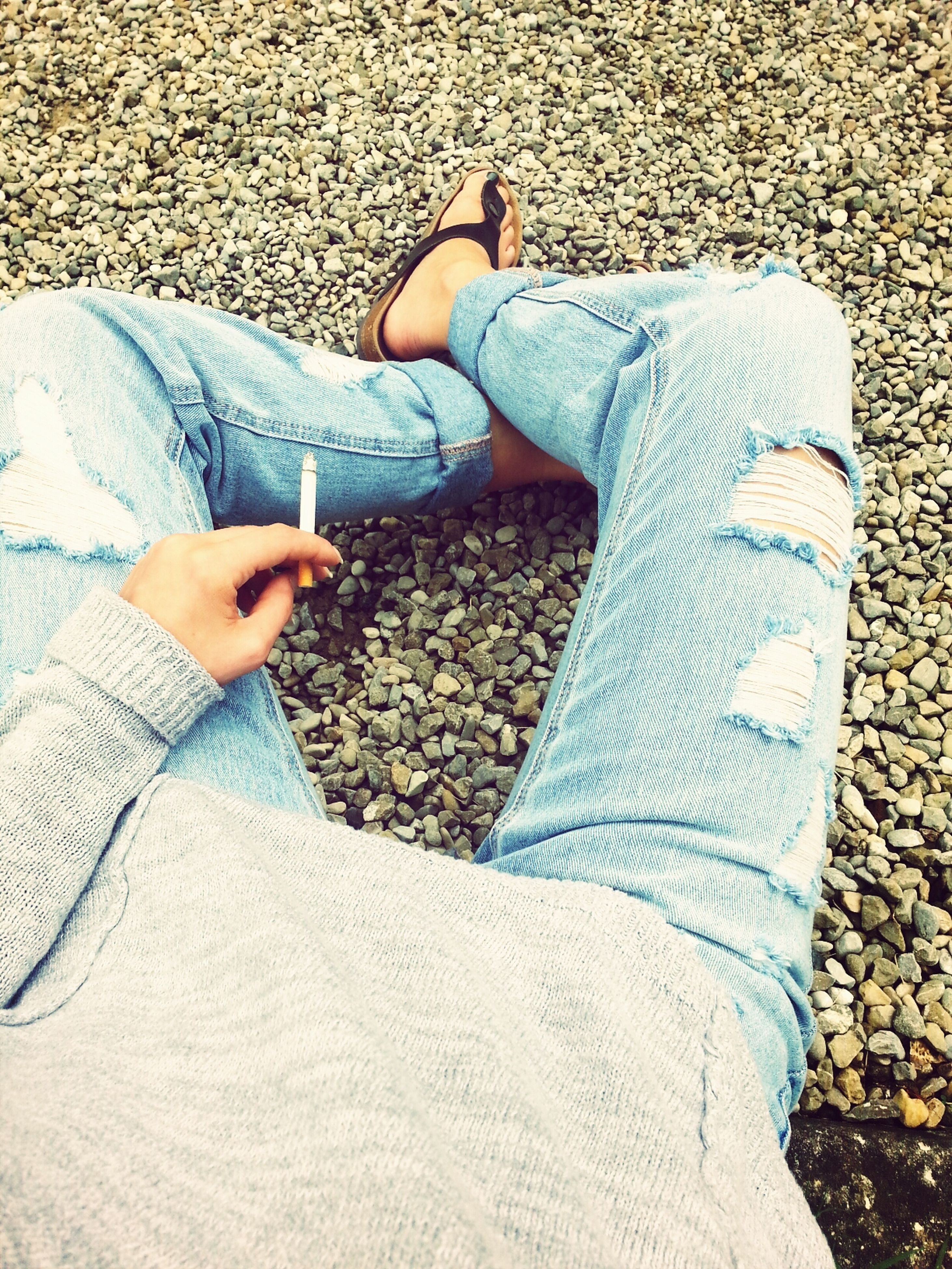 low section, person, lifestyles, shoe, standing, jeans, leisure activity, personal perspective, high angle view, casual clothing, human foot, footwear, sunlight, fashion, day, outdoors