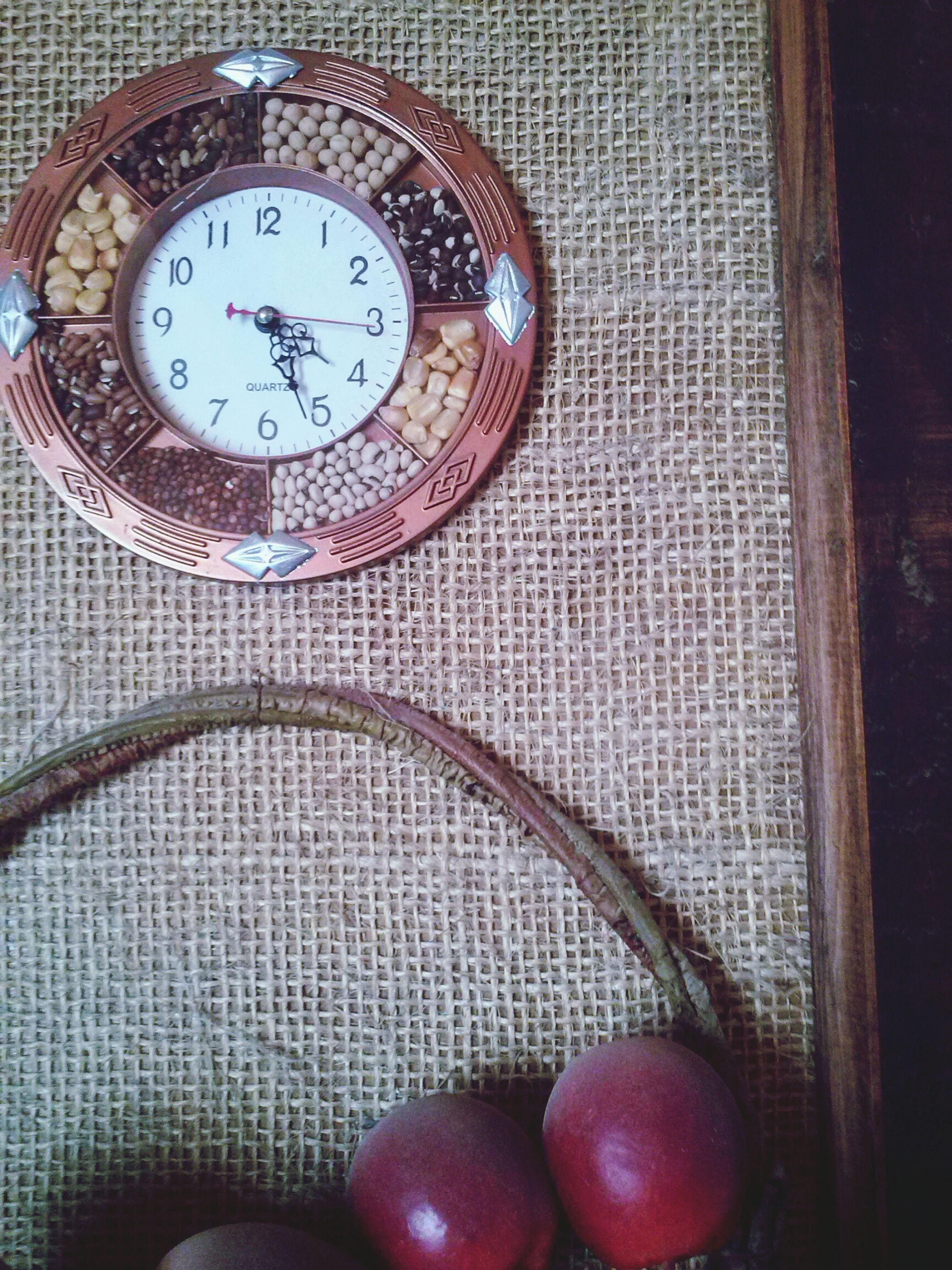 indoors, time, clock, number, communication, text, close-up, old-fashioned, circle, wall - building feature, still life, no people, accuracy, western script, clock face, metal, wood - material, table, technology, day
