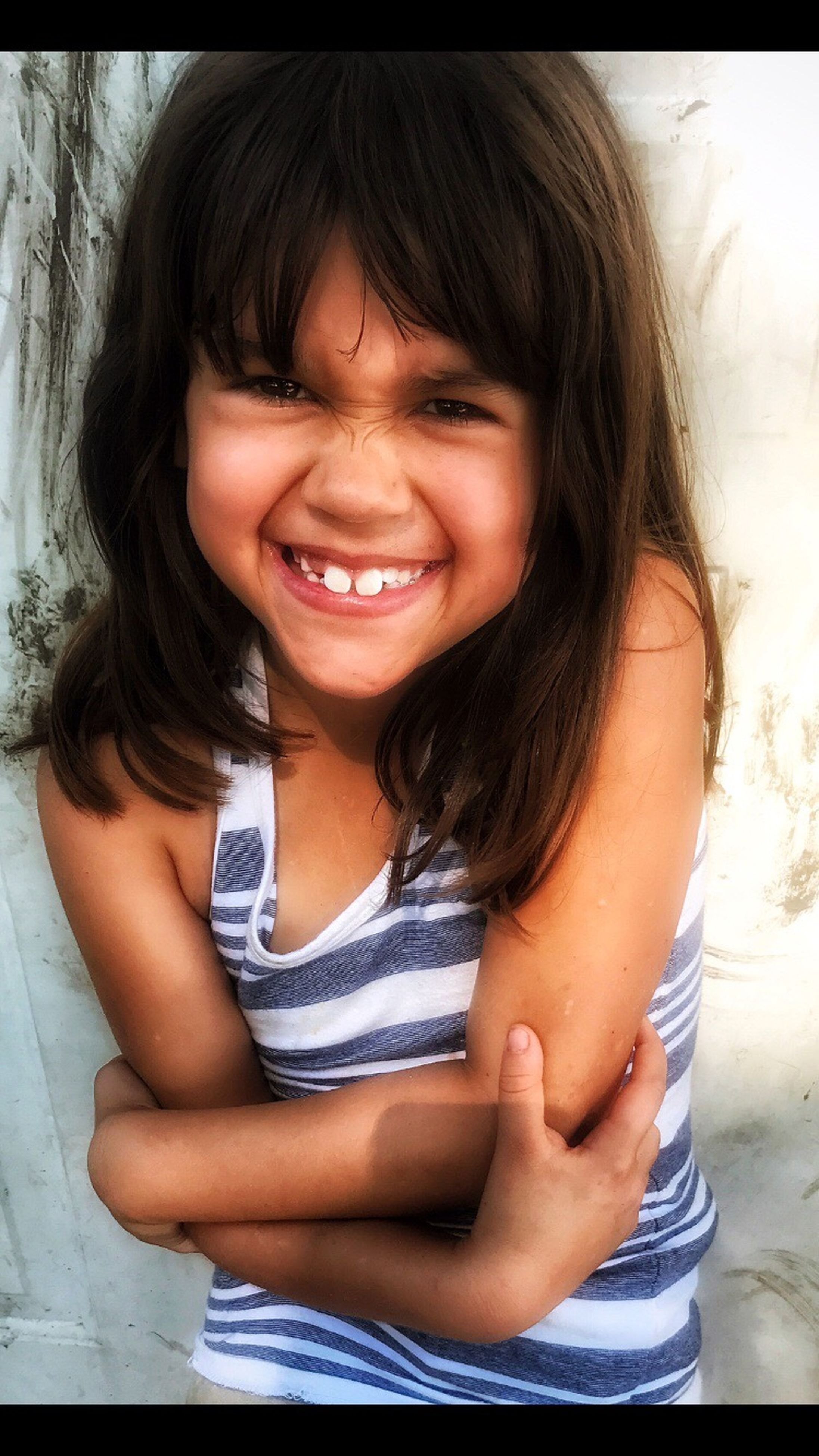 smiling, childhood, looking at camera, happiness, real people, portrait, elementary age, front view, one person, girls, lifestyles, day, close-up, outdoors