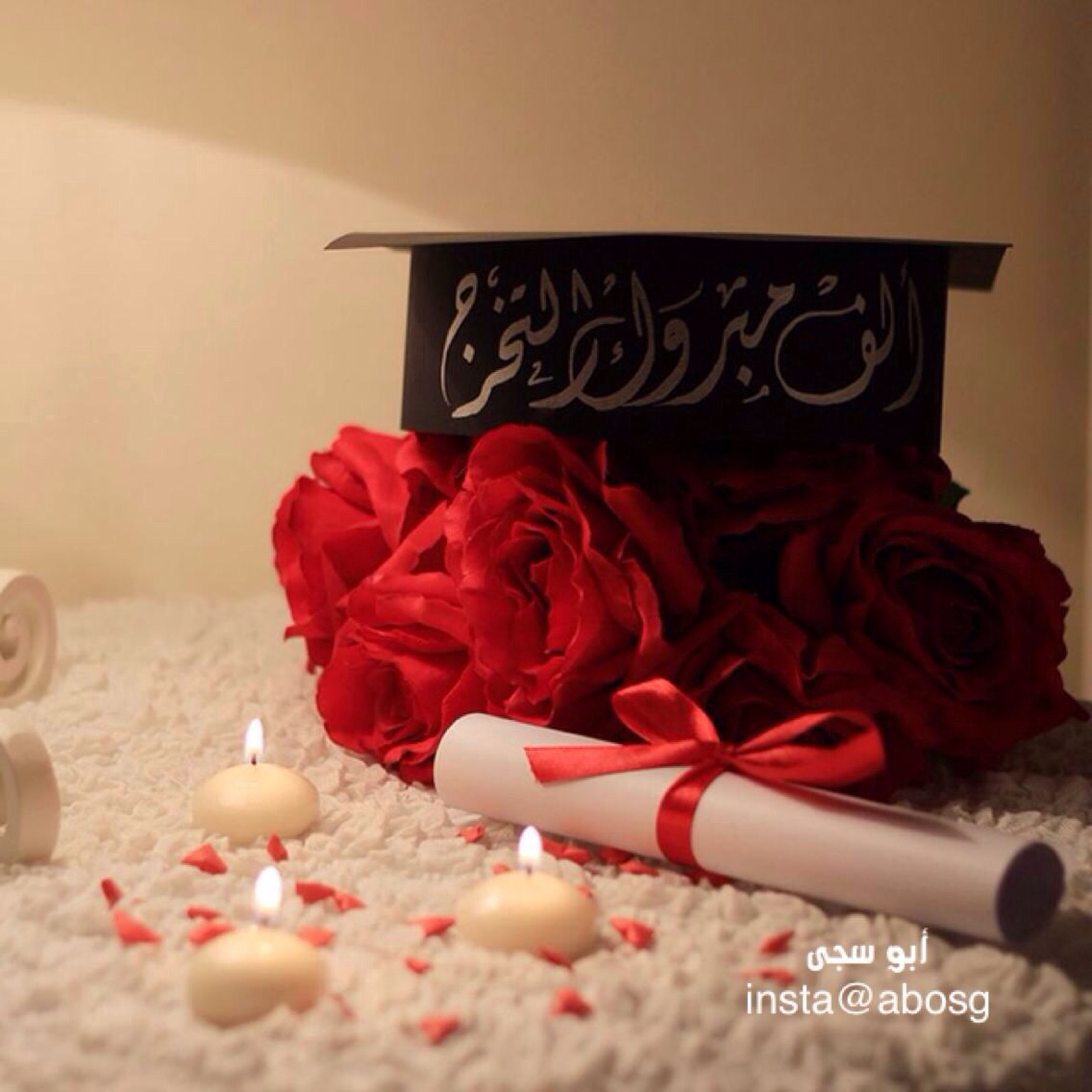 indoors, text, red, art and craft, close-up, focus on foreground, art, flower, creativity, still life, no people, decoration, home interior, western script, paper, communication, religion, pink color, wall - building feature, selective focus