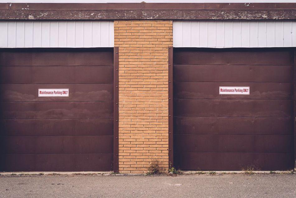 Built Structure Text Architecture Building Exterior Door Communication Outdoors Entrance No People Day Garage Doors Garage Door