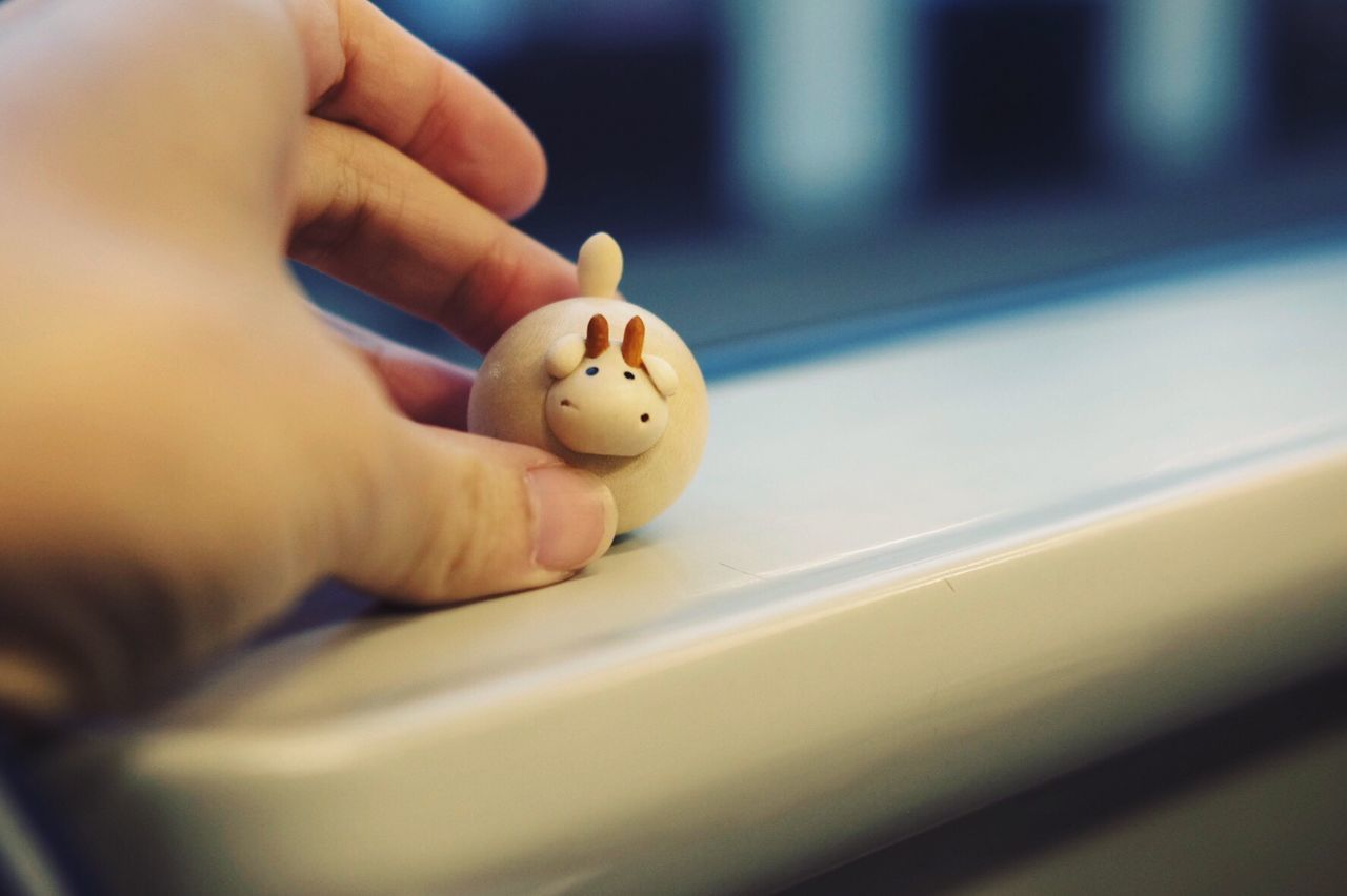Human Hand Human Finger Human Body Part Real People One Person Close-up Leisure Activity Indoors  Day People Goods Toy Cute Cow