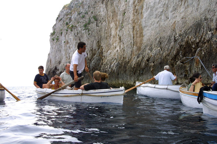 Tourist rowing boats entering the Blue Grotto - Capri, Italy Adult Blue Grotto Capri, Italy Day Leisure Activity Lifestyles Medium Group Of People Men Nature Nautical Vessel Outdoors People Real People Rowing Boats Sea Sitting Sky Teamwork Togetherness Water