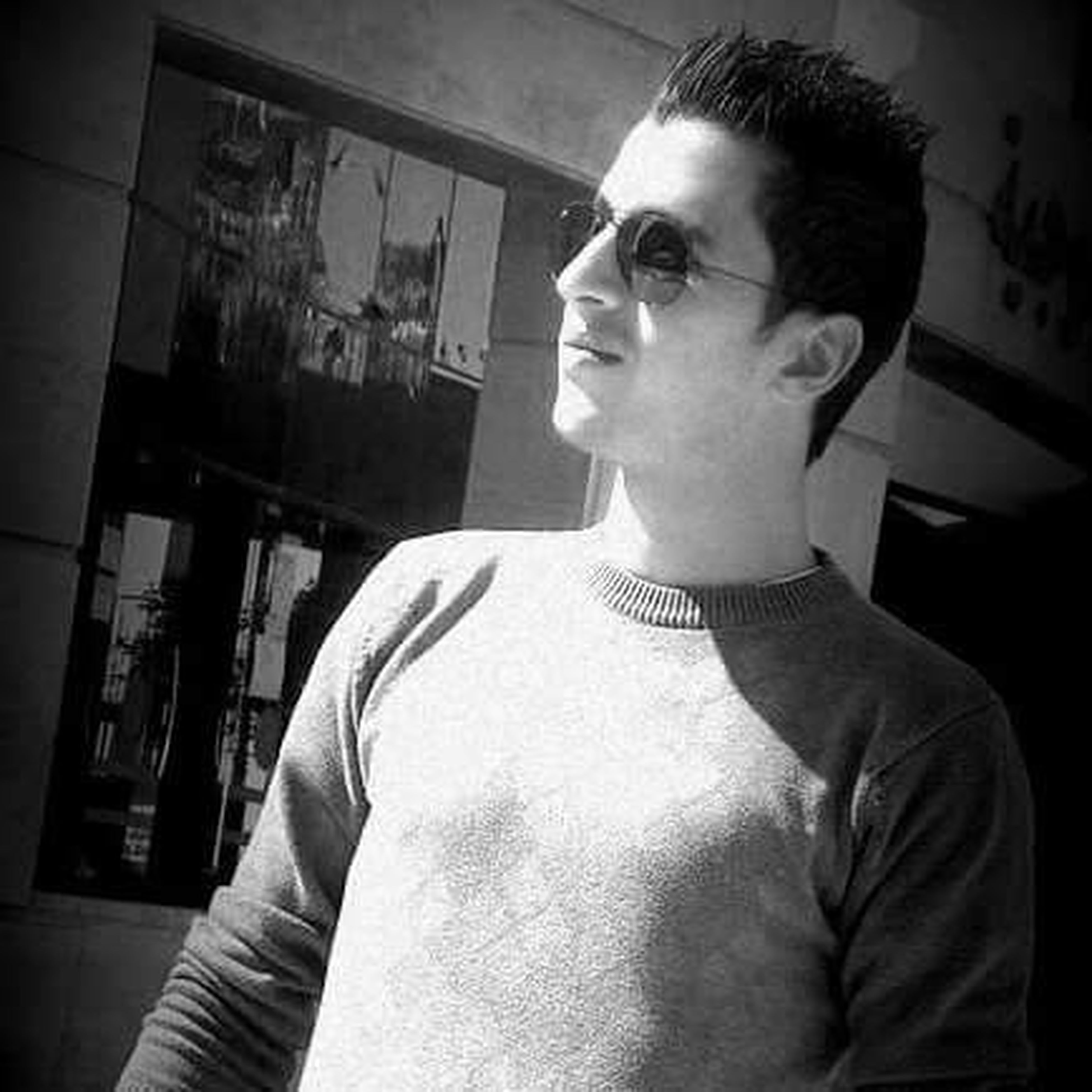 young adult, casual clothing, indoors, headshot, looking away, sunglasses, well-dressed, person, front view, hairstyle, fashionable, retail, handsome, contemplation, serious, looking