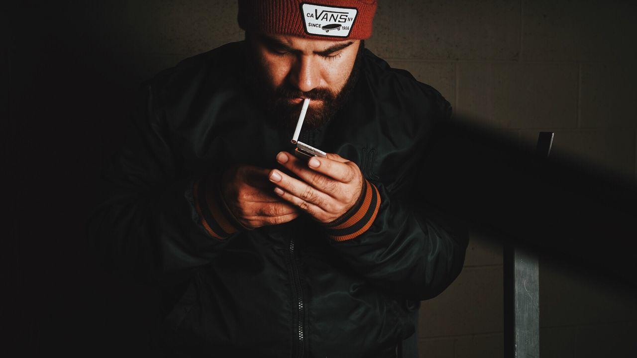 Dark places. Portrait Lowlightphotography Moody Splitlighting Cigarrette Smoking Beanie Lonely