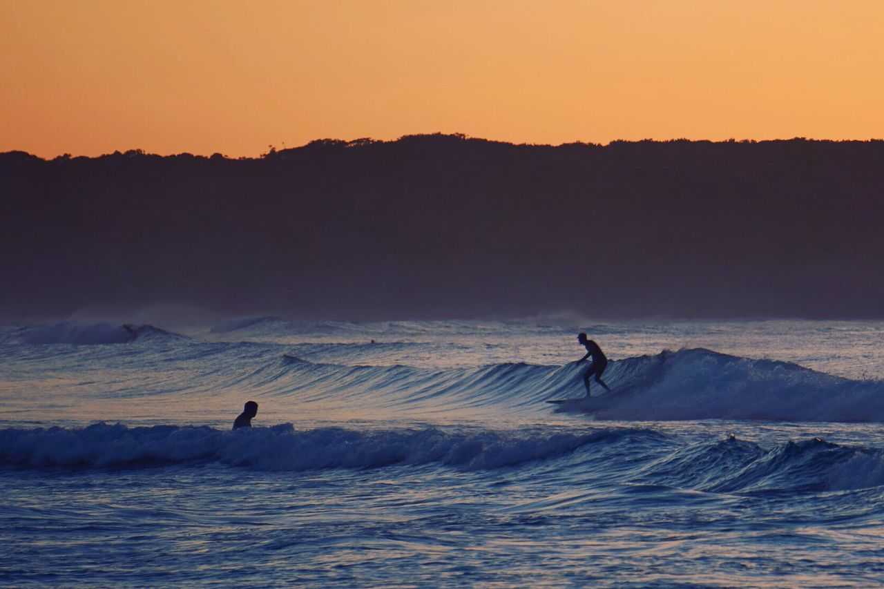 Real People Sunset Nature Beauty In Nature Silhouette Leisure Activity Scenics Adventure Wave Extreme Sports Mountain Surfing Lifestyles Vacations Outdoors Motion Sport Two People Sky Men Sunrise