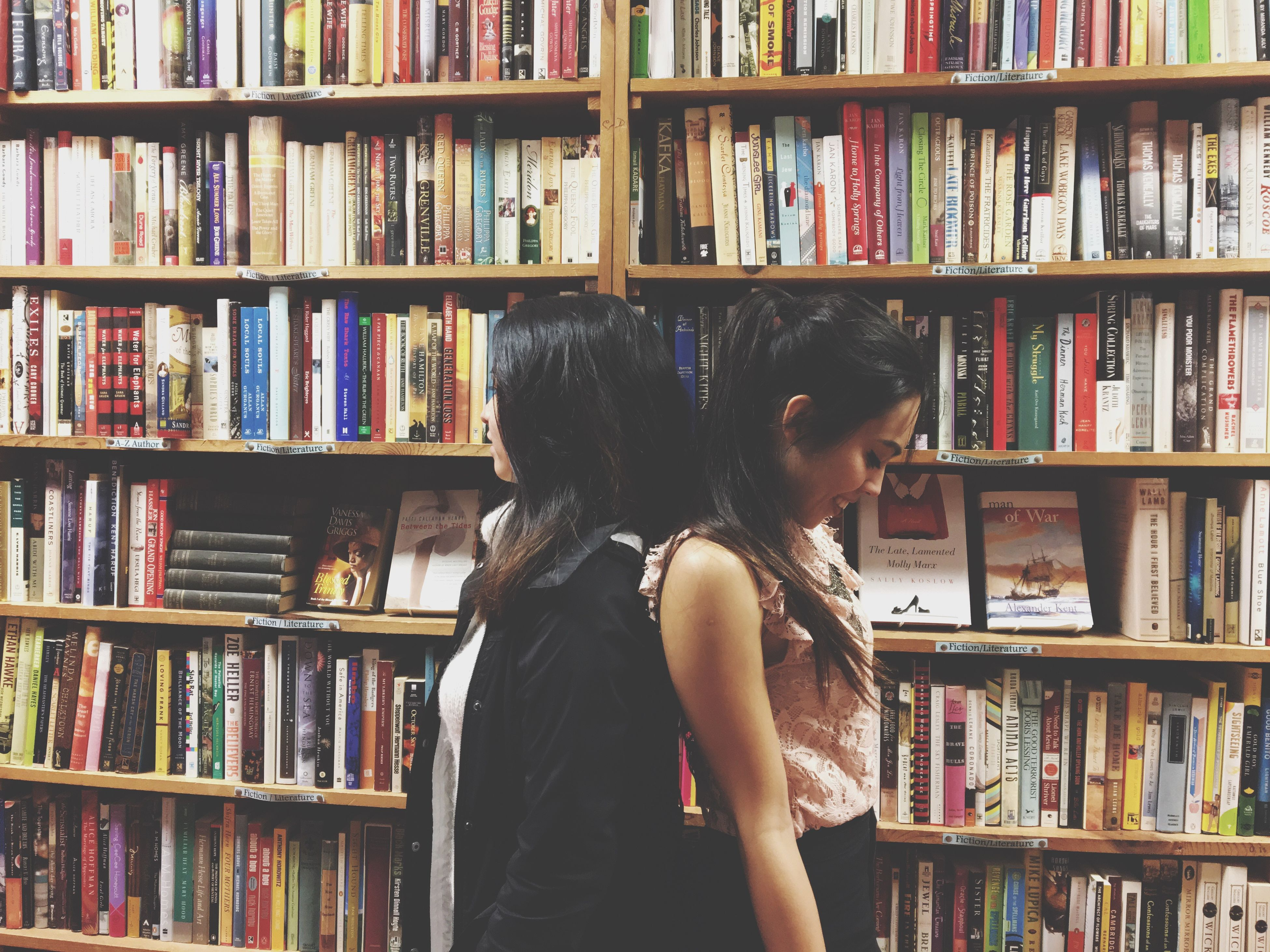bookshelf, book, shelf, library, indoors, one person, young adult, large group of objects, education, adults only, people, only women, one woman only, young women, choice, one young woman only, bookstore, adult, day
