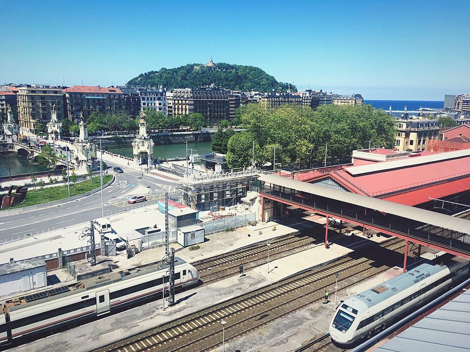 Transportation Architecture Mode Of Transport Public Transportation Built Structure Train - Vehicle High Angle View Day Building Exterior Railroad Track City Rail Transportation Outdoors Clear Sky Sunlight Land Vehicle Cityscape No People Tree Commuter Train