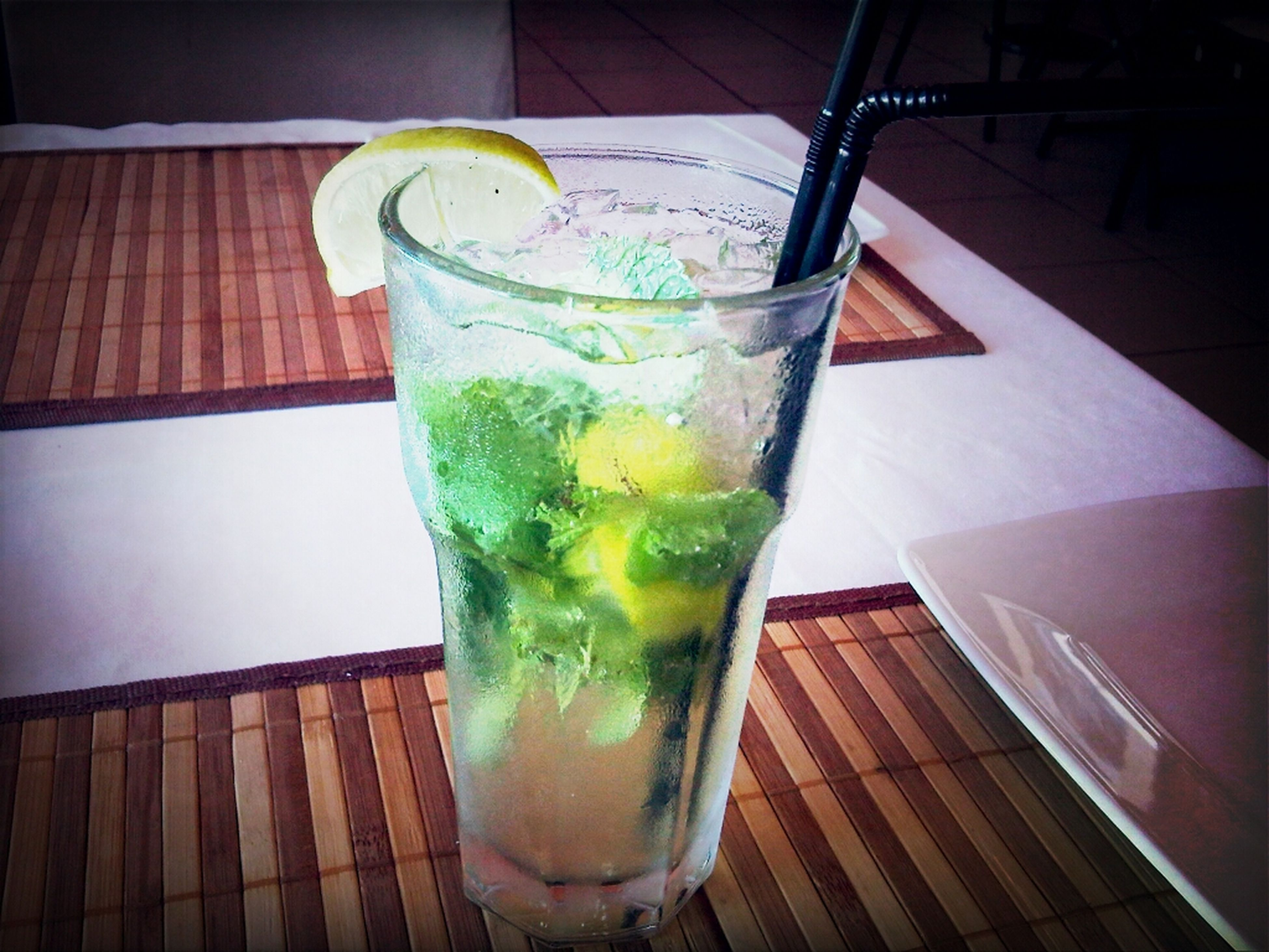 drink, food and drink, table, refreshment, indoors, drinking glass, freshness, still life, glass - material, drinking straw, close-up, glass, juice, healthy eating, alcohol, cocktail, no people, restaurant, green color, lemon