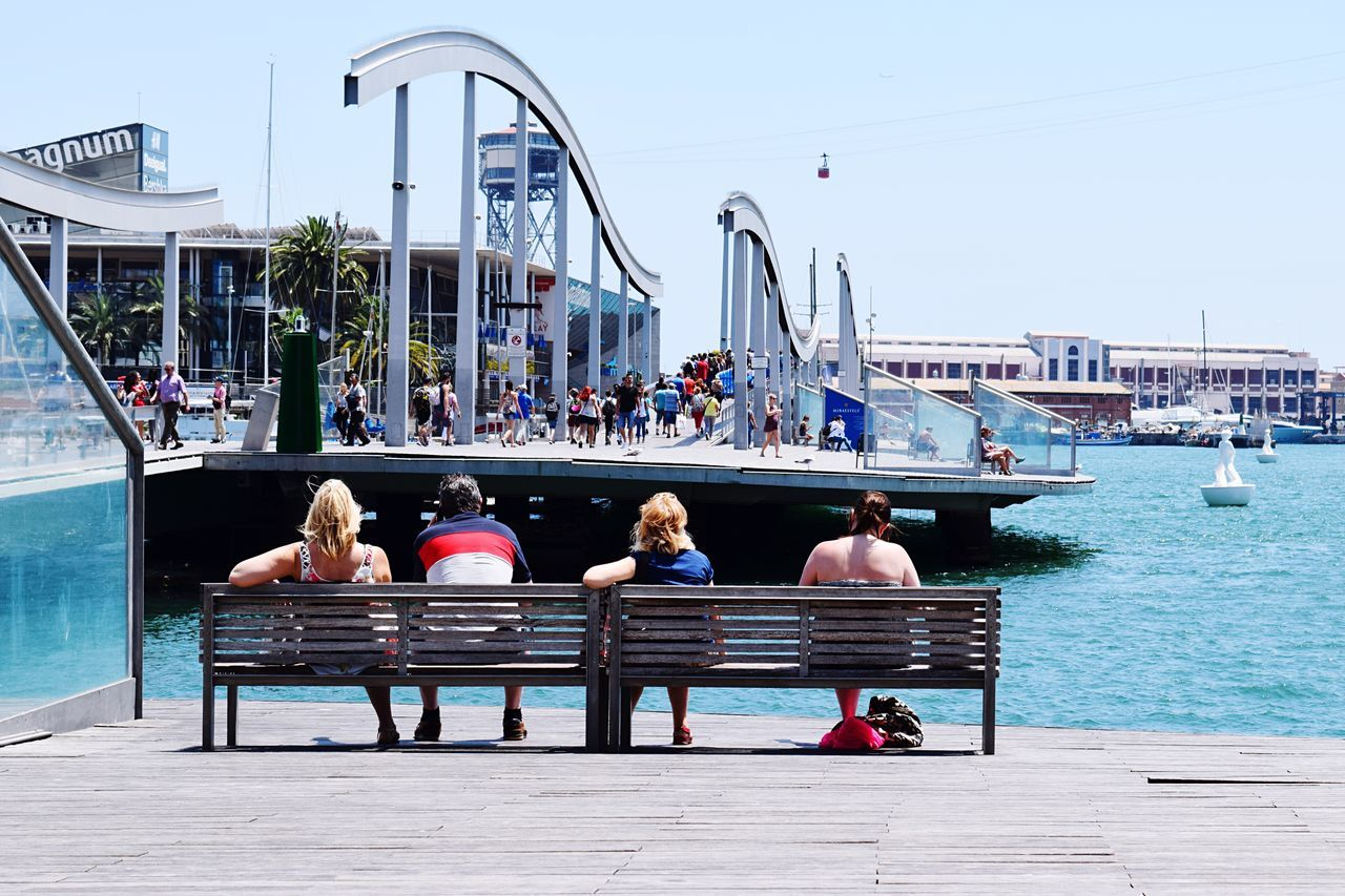Barcelona Port Barcelona, Spain Water Sitting Travel Destinations Adult Adults Only Relaxation Togetherness Men Women Outdoors Leisure Activity Swimming Pool Nautical Vessel Real People Transportation Vacations Lifestyles People Full Length Young Adult Tourism Commercial Dock Neon Life EyeEm Selects