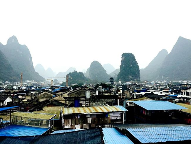 Yangshuo Rooftop View China. Yangshuo Rooftop View  Rooftop Scenery Mountains In Background China Beauty China Mountain China Highlights China Building