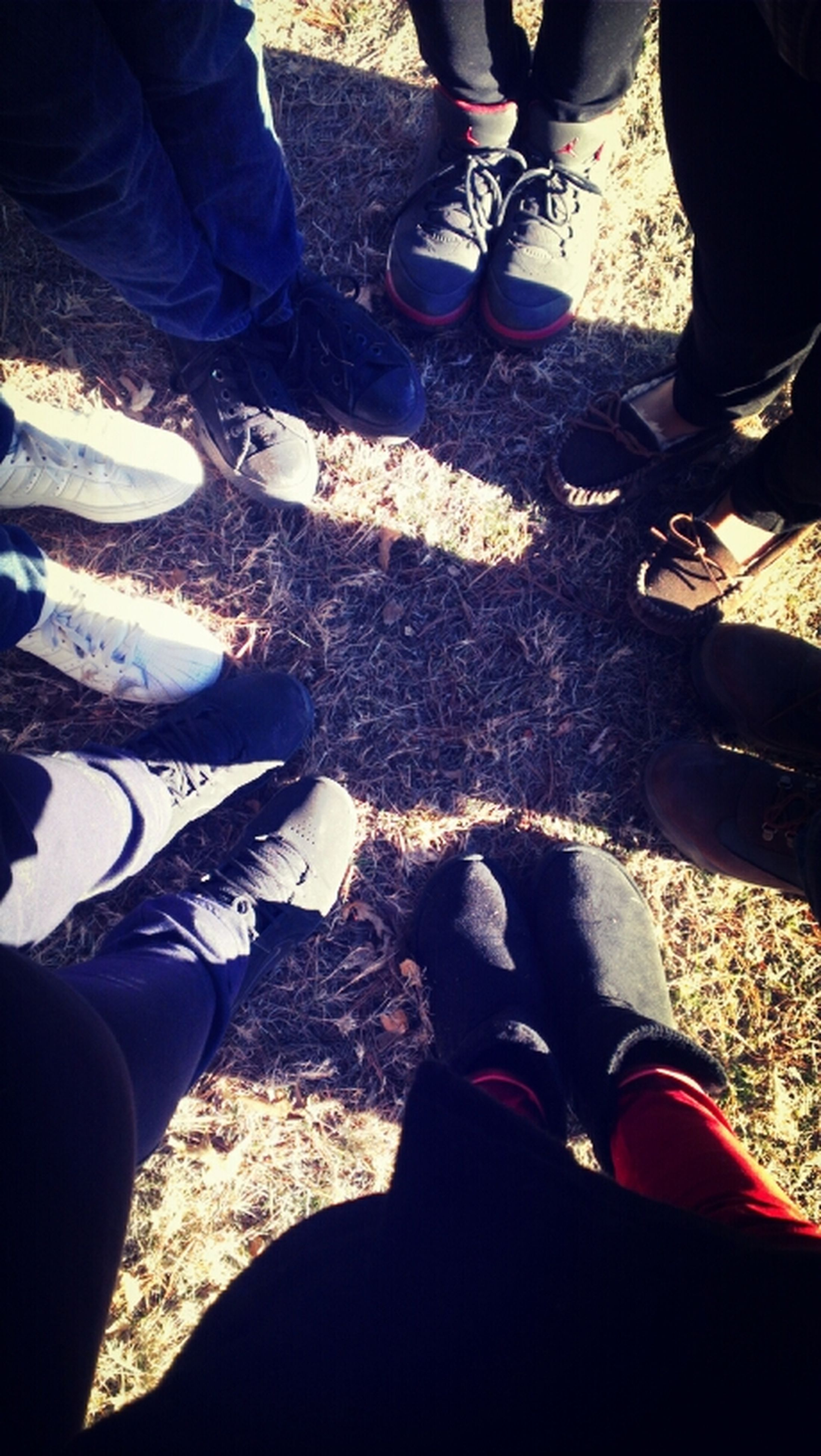 low section, person, shoe, lifestyles, human foot, men, togetherness, leisure activity, personal perspective, standing, bonding, high angle view, footwear, friendship, jeans