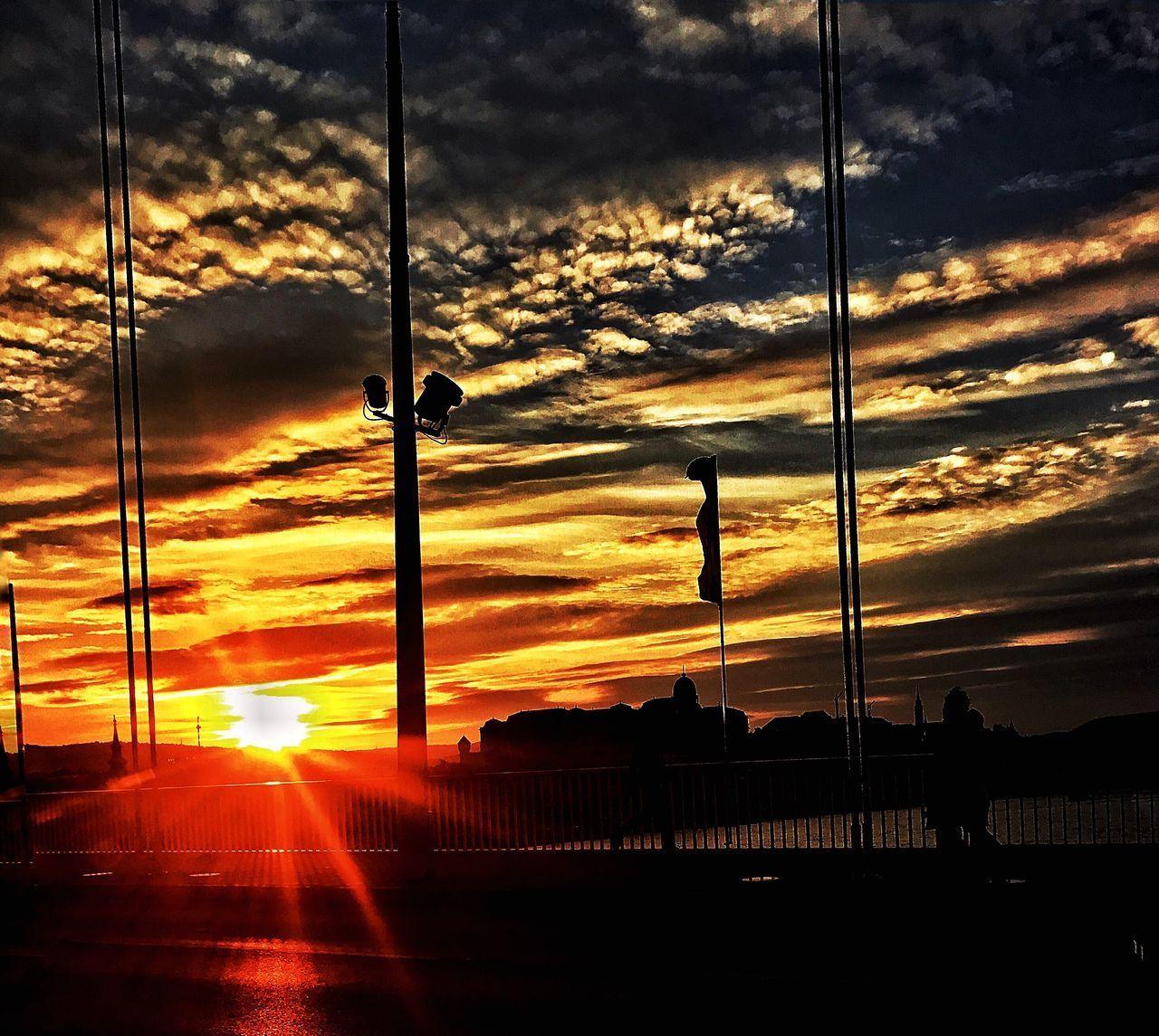 sunset, cloud - sky, sky, silhouette, sun, orange color, sunbeam, sunlight, nature, no people, built structure, transportation, outdoors, architecture, beauty in nature, scenics, day
