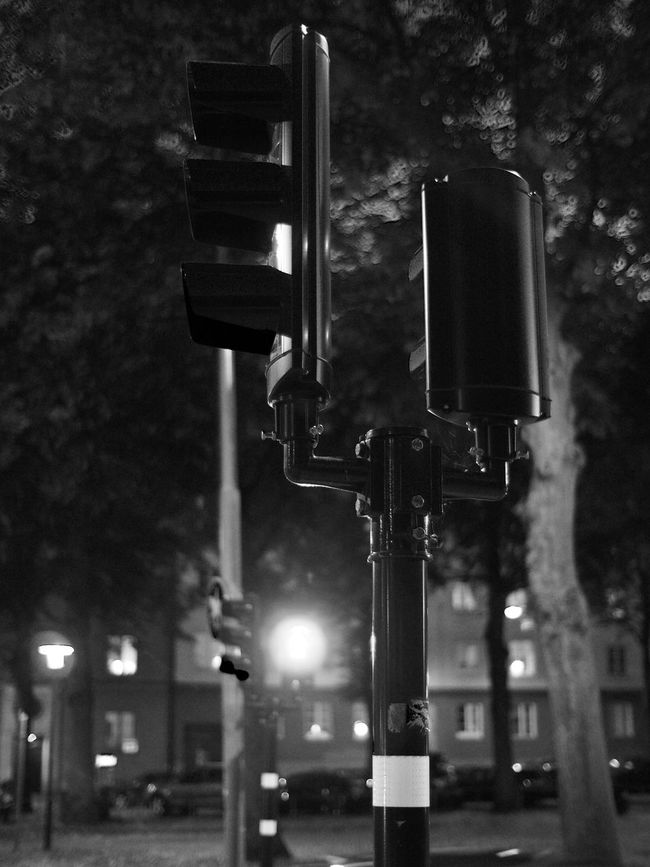 Illuminated Lighting Equipment Street Light Pole Street Night Road Low Angle View Stoplight Road Signal Traffic Light  City In A Row Outdoors Sky Lamp Post Cloud Focus On Foreground City Life Lamppost Shallow Depth Of Field Blackandwhite Black And White Black & White Monochrome