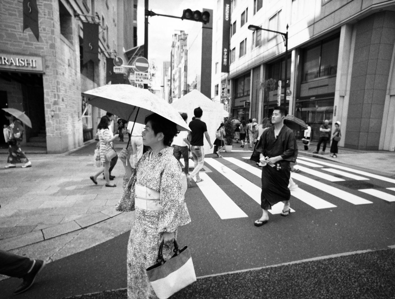Tsukiji fish market in Tokyo, Japan Adult Adults Only blackandwhite building exterior City City Life City Street day Japan large group of people Market men monochrome outdoors people people and places People watching street street photography Tokyo travel destinations Traveling walking Welcome to Black women