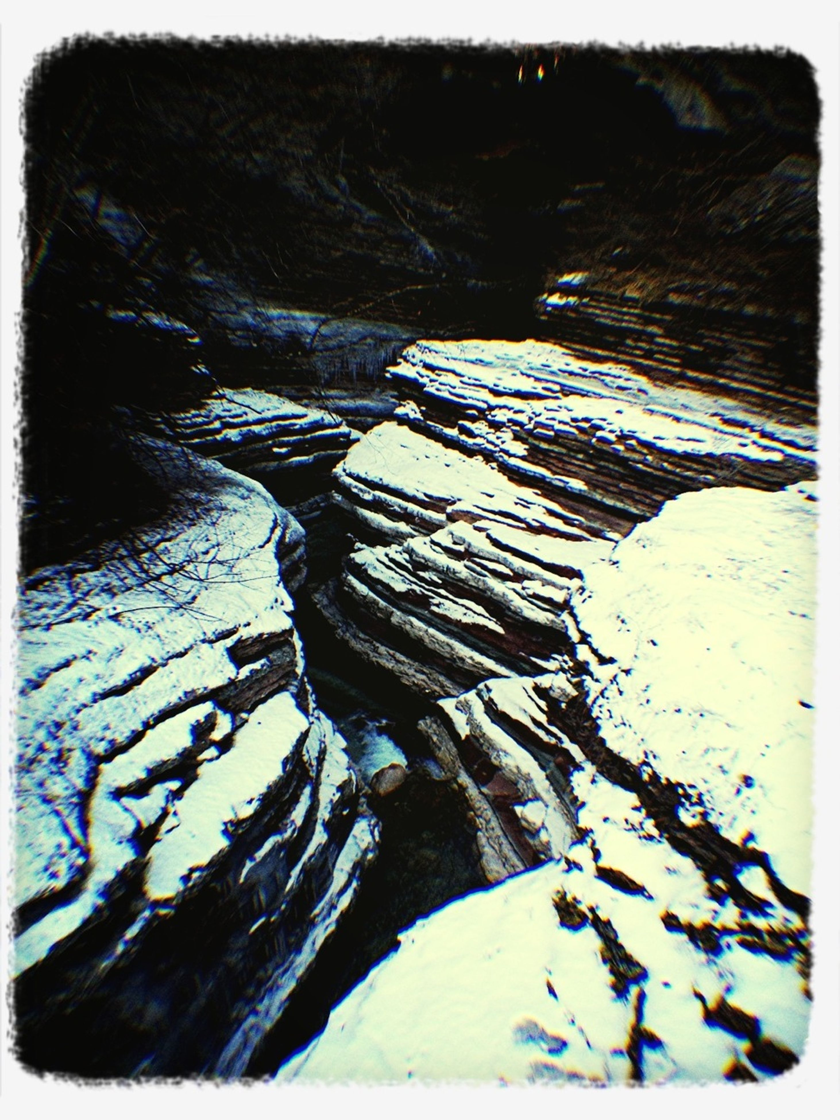 transfer print, auto post production filter, tranquility, rock - object, nature, rock formation, tranquil scene, beauty in nature, water, scenics, outdoors, rock, day, high angle view, snow, no people, natural pattern, geology, non-urban scene, winter