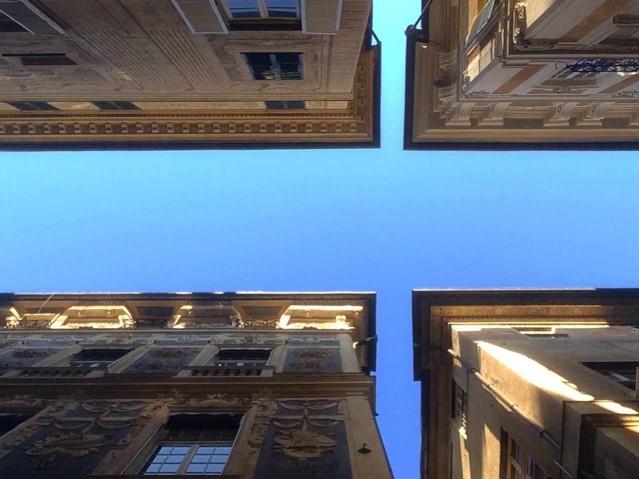 shoots from camera roll of about a year ago Architecture Blue Building Exterior Built Structure City Clear Sky Day Illuminated Low Angle View No People Outdoors Sky Window