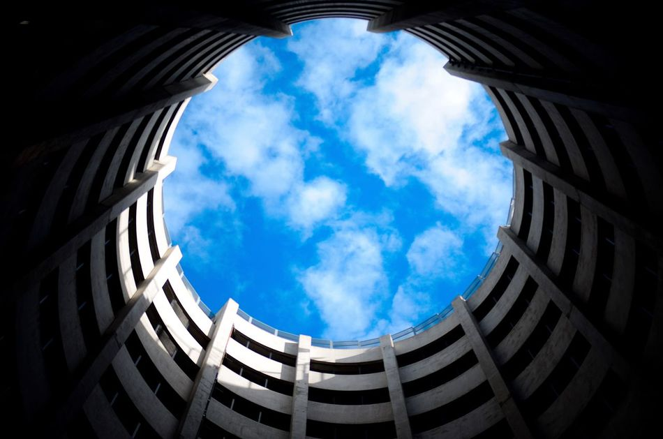 The Secret Spaces (Instagram: @iamjosway) Cloud - Sky Architecture Sky Built Structure Low Angle View Day Sunlight Blue Building Exterior No People Travel Destinations Outdoors DetroitMichigan Downtown Symmetry Detroit Michigan Motorcityshooters