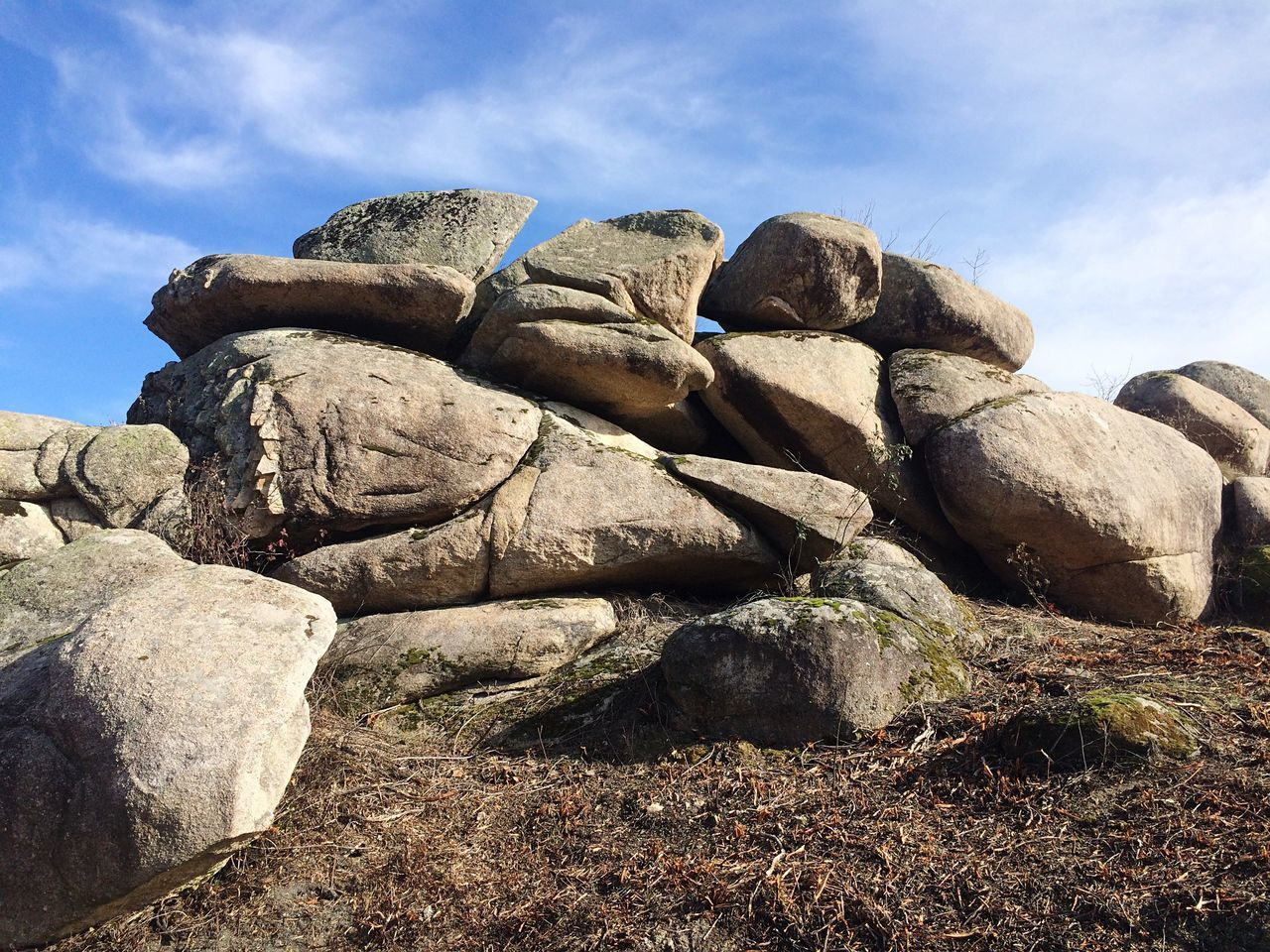rock - object, nature, day, beauty in nature, cloud - sky, sky, outdoors, tranquility, tranquil scene, no people, scenics, low angle view, landscape