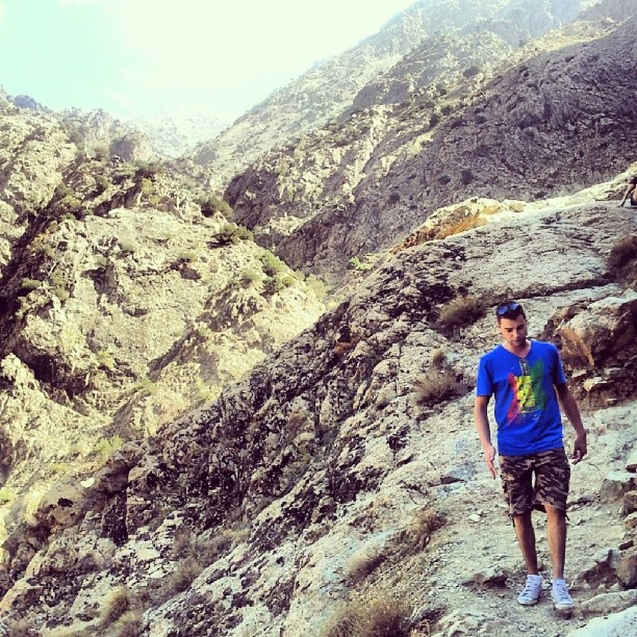 real people, mountain, one person, backpack, adventure, hiking, men, rear view, nature, leisure activity, rock - object, lifestyles, full length, standing, casual clothing, day, outdoors, young men, young adult, scenics, one man only, landscape, beauty in nature, climbing, sky, only men, adult, adults only, people