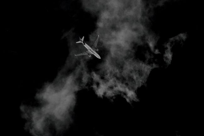 Sky Sky_collection Clouds Cloud - Sky Cloud_collection  Lookingup Flying Airplane Air Vehicle Aircraft Low Angle View Vapor Trail Outdoors Up In The Air Transportation Holidays Minimalism Blackandwhitephotography Black&white Blackandwhite