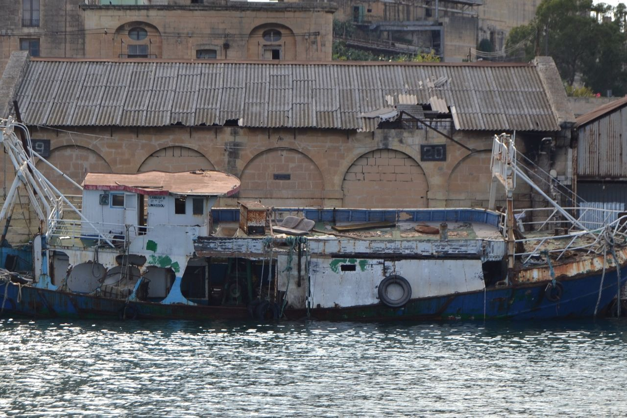 Delapidated boat staying just afloat but not for long, at Valletta harbours and creeks, Malta, Europe. Architecture Delapidated Boat Malta Moored Nautical Vessel No People Old Boat Transportation Travel Destinations Travel Photography Water