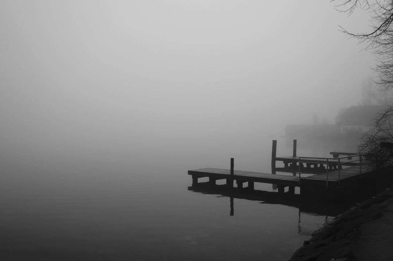 Piers Over River Against Sky During Foggy Weather